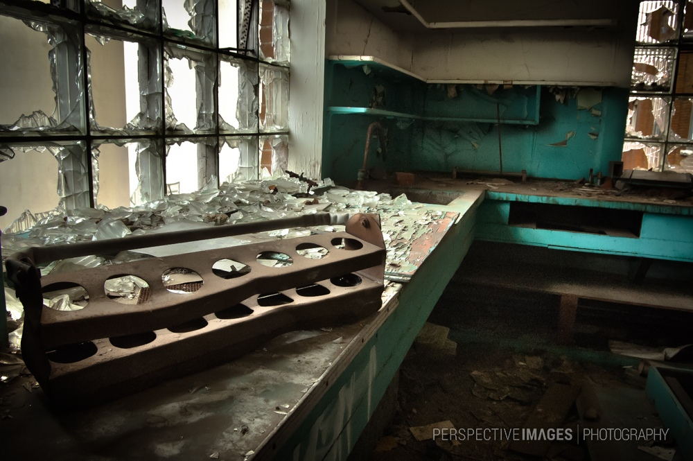 Rats in the Lab - A rusted test tube holder in the former sugar mill.