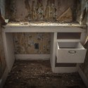 The Last Draw - A writing desk sits abandoned in the house of a former mine worker.