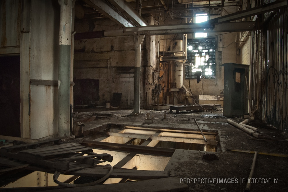 The Fire Below - Salvaged machinery has left gapping holes in the floor.