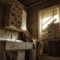 Shutting Out the Light - Broken blinds and boarded windows keep this kitchen in darkness.