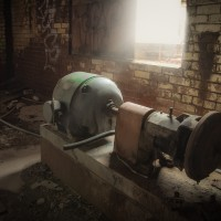 Loss of Power - Abandoned electric motor collecting dust at a former sugar mill