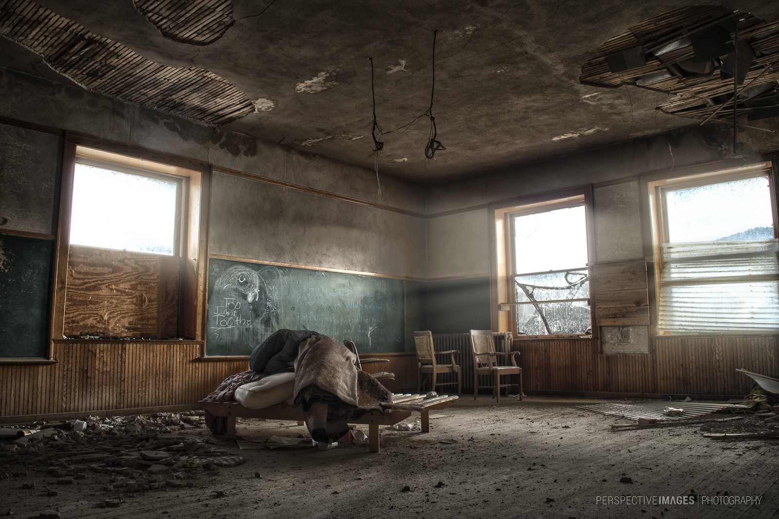 Shine On - Crumbling ceiling plaster falls in chunks at an abandoned school house.