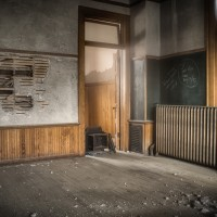Between the Walls - School House reduced to crumbling plaster and boarded up windows.