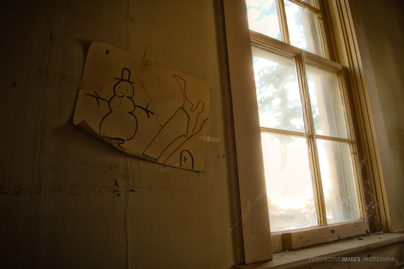 I Drew This For You - A child's drawing still hangs near the window of an abandoned house.