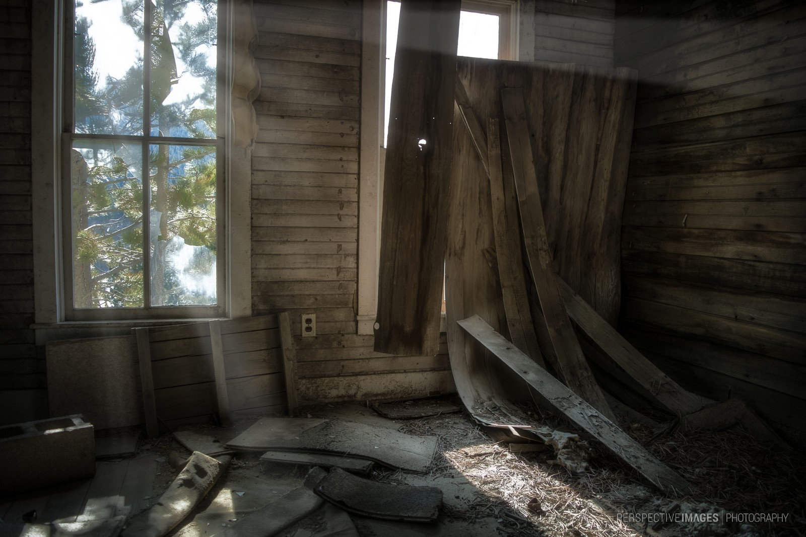 Collapsing windows and walls give way to the elements.