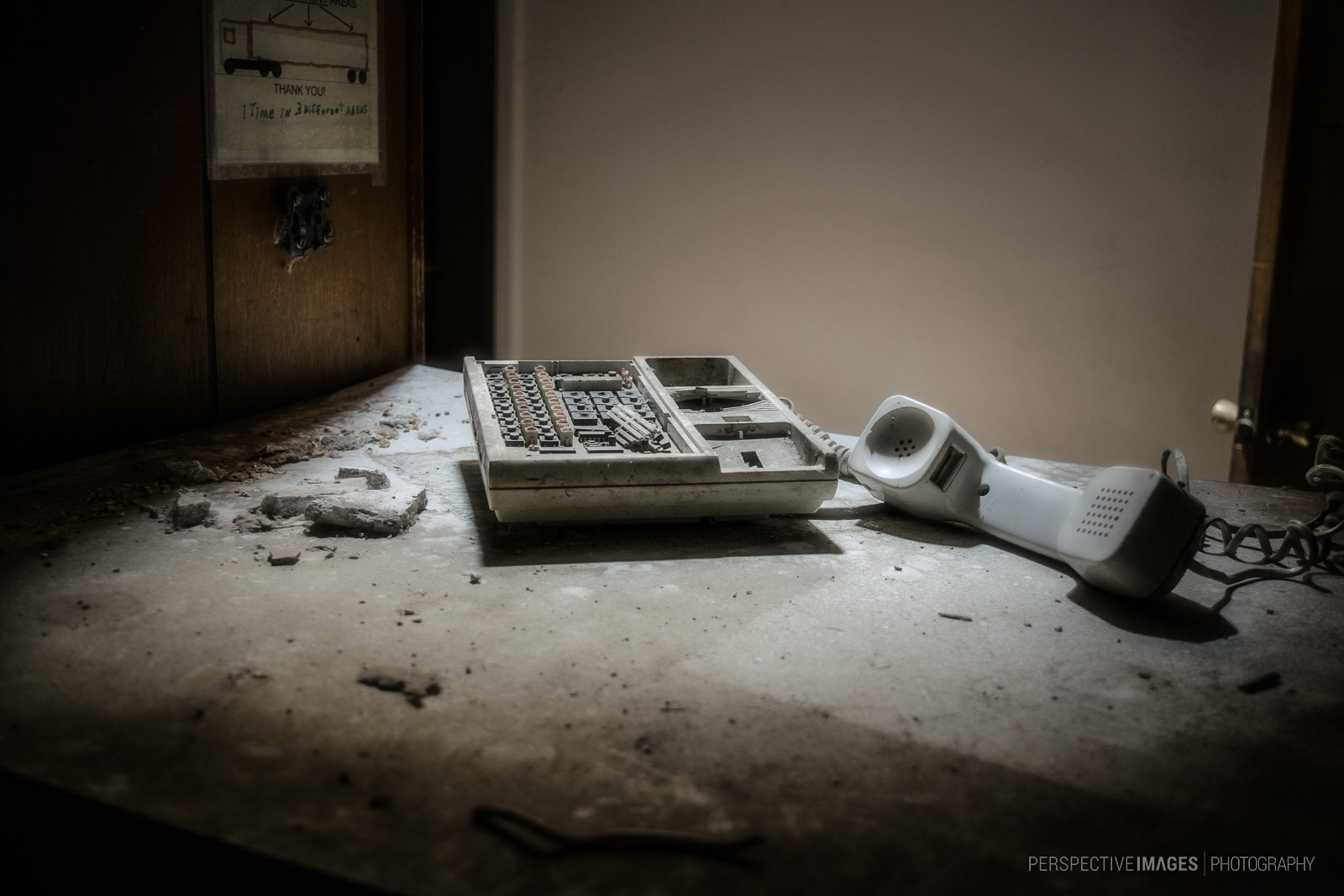 I Called but No One Answered - A smashed phone sits at the front desk of the feedlot office.
